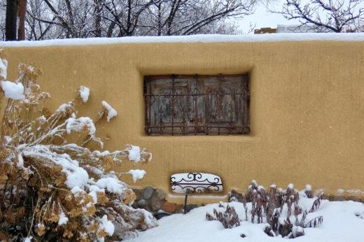 pueblo house in snow